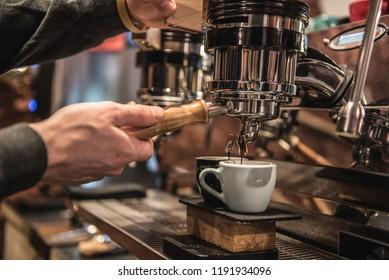 barista preparing coffee via espresso machine/waiting for my afternoon refreshment