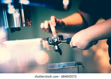 Barista presses ground coffee using tamper, Toned picture