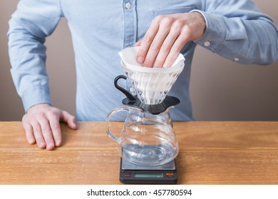 Barista runs the complex filter in a funnel for purovera V60