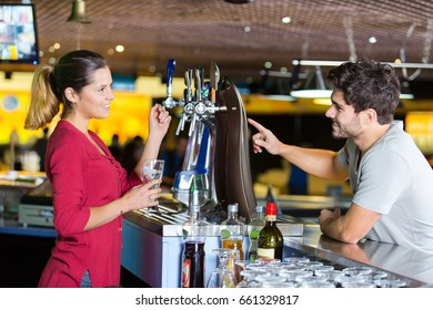 barista shows how coffee machine works