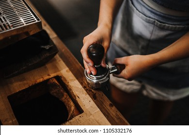 Barista tamping coffee. Coffee making process