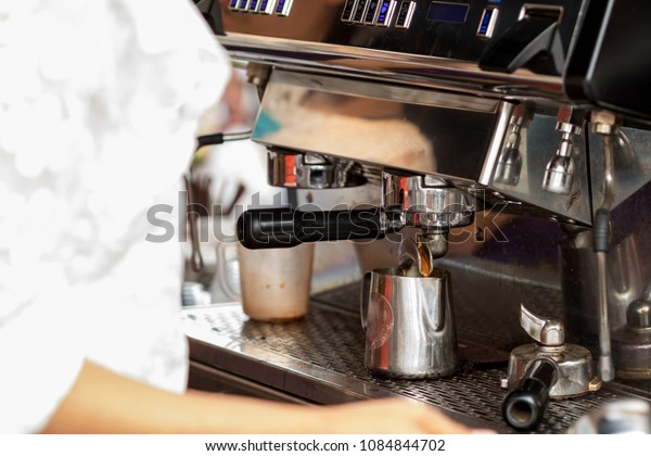 Barista use coffee grinder with coffee beans