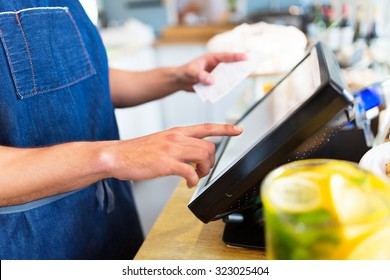 Barista using cash counter