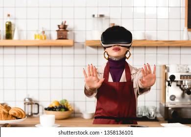 barista in virtual reality headset standing near bar counter in coffee shop