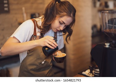 Barista woman make a coffee in the cafeteria