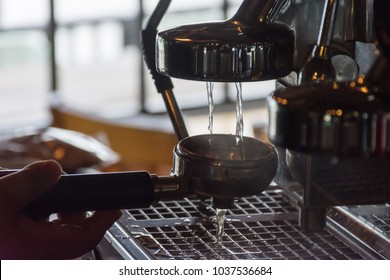 Barista is working on coffee machine for  serve to customer