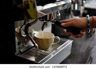 Barista's hand making coffee  with coffee machine