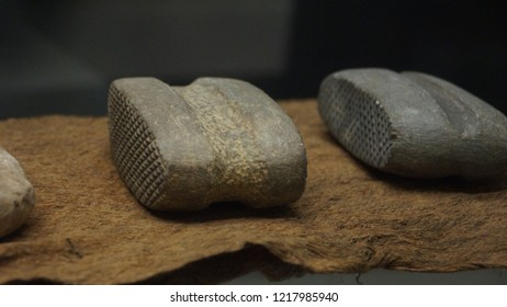 Bark Cloth Beaters - The stone tools with inscribed criss-cross line used to beat and soften tree bark to make a cloth