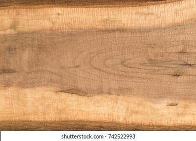 Bark edge rough sawn walnut board close up
