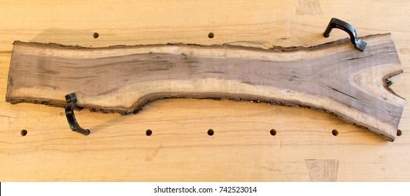 Bark edge rough sawn walnut board on traditional workbench