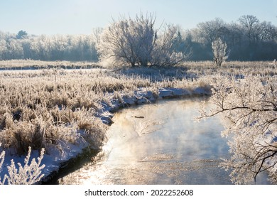 The Bark River in Waukesha County Wisconsin on a clear cold winter's morning.  Hoar frost covers the river bottom.