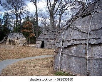 Bark-covered wigwams at a reconstructed Native American village in Maryland, home to the Nanticoke, Shawnee, Piscataway, Lenape, Tuscarora, and Susquehannock nations.