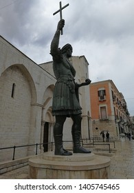Barletta, Puglia, Italy - May 18, 2019: The Colossus of Barletta, the great bronze statue of Heraclius, in front of the Basilica of the Holy Sepulcher