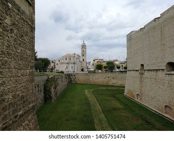 Barletta, Puglia, Italy - May 18, 2019: Cathedral of Santa Maria Maggiore from the bridge over the moat of the Svevo Castle