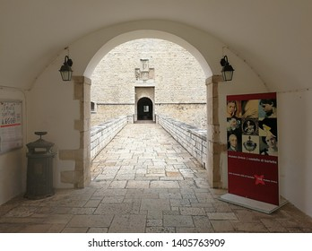 Barletta, Puglia, Italy - May 18, 2019: Access to the bridge over the moat of Castello Svevo from the ravelin