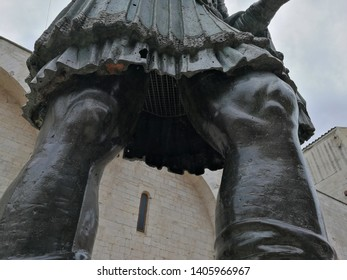 Barletta, Puglia, Italy - May 18, 2019: Detail of the Colossus of Barletta, the large bronze statue of Heraclius in front of the Basilica of the Holy Sepulcher