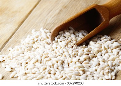 Barley groats on the kitchen wooden table