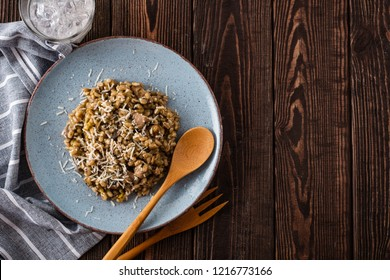 Barley porridge with mushrooms and chicken, top view.