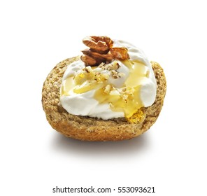 barley rusk called dakos ,topped with yogurt, honey and nuts