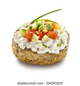 barley rusk called dakos ,topped with cottage cheese, tomato and cucumber cubes ,typical Greek plate served with ouzo or raki