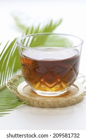 The Barley Tea Made Up Of Glass And The Sprout Of Cycad