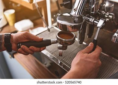 barman attaching portafilter to the apparatus