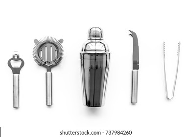 Barman equipment. Shaker, strainer on white background top view