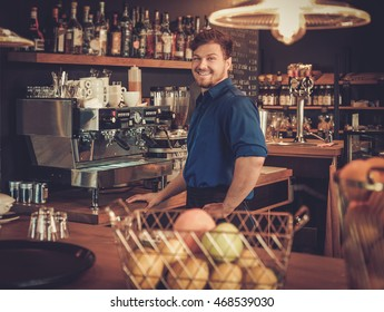Barman having fun at bar counter in bakery.