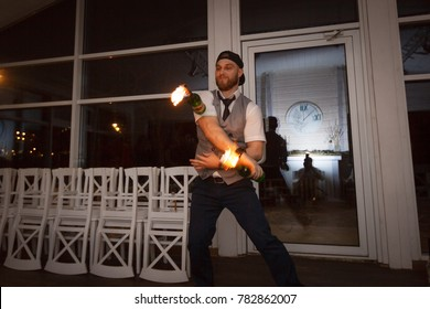 Barman make a fire show and do flairing