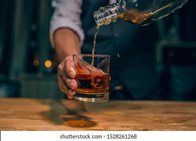 Barman pouring whiskey whiskey glass beautiful night - Shutterstock ID 1528261268