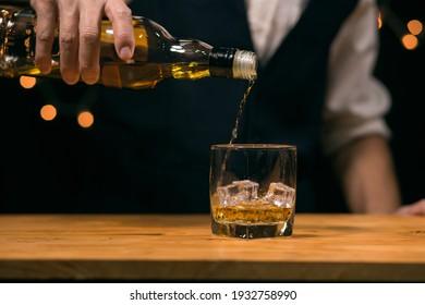 Barman pouring whiskey whiskey glass beautiful night