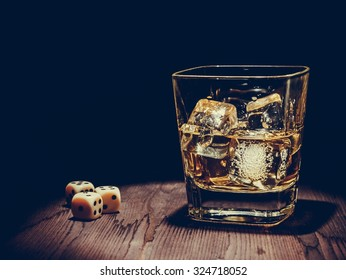barman pouring whiskey in the glass on wood table, warm atmosphere, old western style, time of relax with whisky
