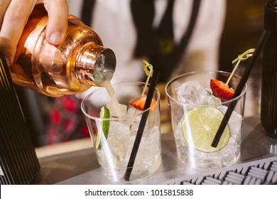 Barman preparing a gin and tonic.