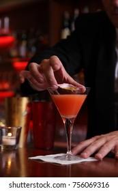 barman preparing a passion fruit cocktail