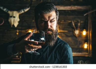 Barman. Pub retro vintage interior. Hipster barman concept. Swag guy with alcohol. Drunk man. Whiskey, brandy, cognac concept