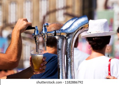 barman serving draft beer  pouring in street fest
