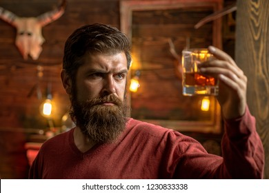 Barman with whisky or brandy. Bearded man drinking alcohol. Drink and celebration party concept. Degustation and tasting