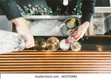 Barman at work. Bartender preparing cocktails