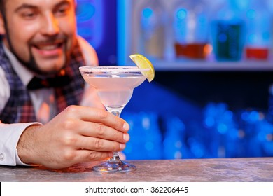 Barman at work, preparing cocktails.