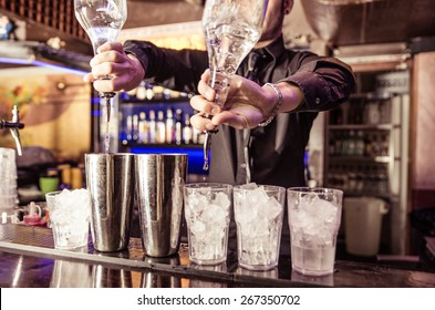 Barman at work, preparing cocktails. concept about service and beverages