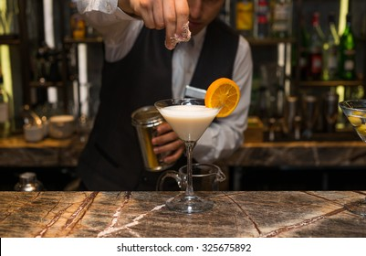 Barman at work, preparing cocktails. preparing pina colada cocktail. concept about service and beverages.