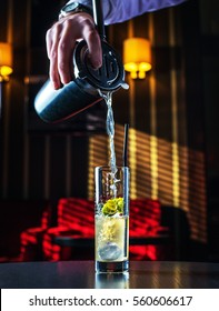 Barman at work, preparing cocktails. pouring Mai tai to cocktail glass. concept about service and beverages.