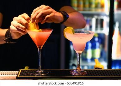 Barmen is making cocktails