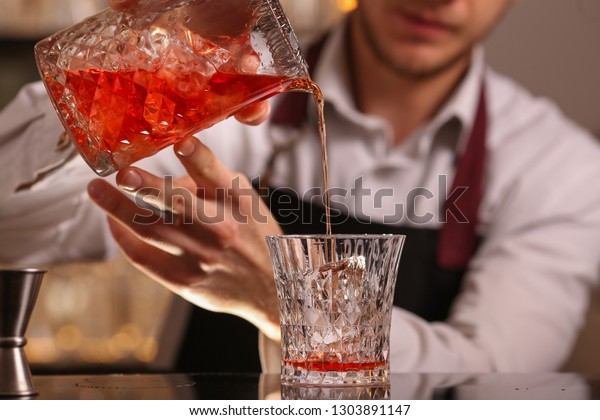 Barmen making negroni alcohol cocktail