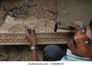Barmer , Rajasthan/India  Dec 12  2009 : Wood Carving  traditional handicraft in india , artisan from Rajasthan doing differnt work for earning .