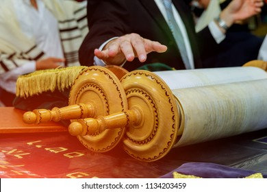Barmitzvah reading Torah scrolls near Bar Mitzva in the Jewish Torah