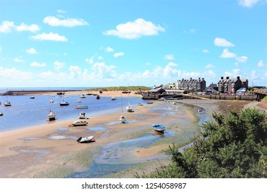 Barmouth, Wales, UK. August 05, 2017. The quayside  and harbor at low tide with beached boats at Barmouth in Wales.