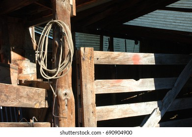 Barn detail photo of fence and lariat.