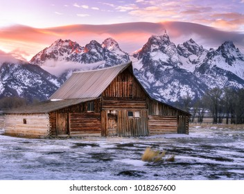 Barn during sunset in front of the Grand Tetons