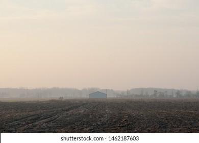 Barn in Empty Farm Field in Midwest at Sunrise